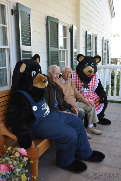 Nick and Ray Tikvica relaxing on the porch of the museum with Papa and Mama Bear
