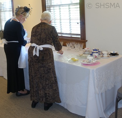 Volunteers preparing the tea service