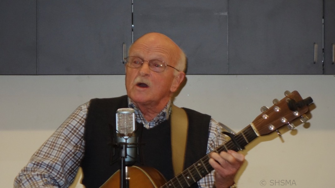 "Jim Reynolds plays the song ""Orphan Train"""