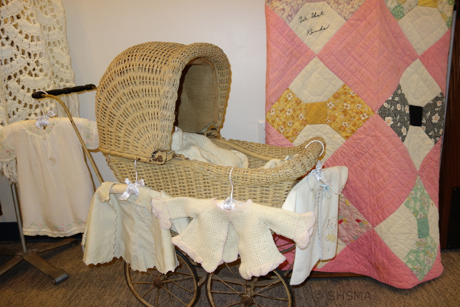 homemade baby clothes and blanket