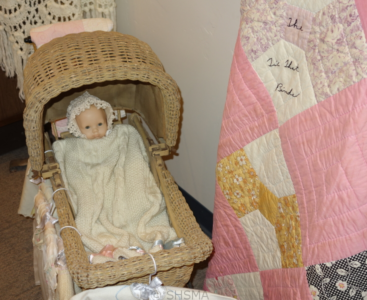 doll in baby buggy