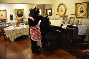 Papa Bear plays the museum piano