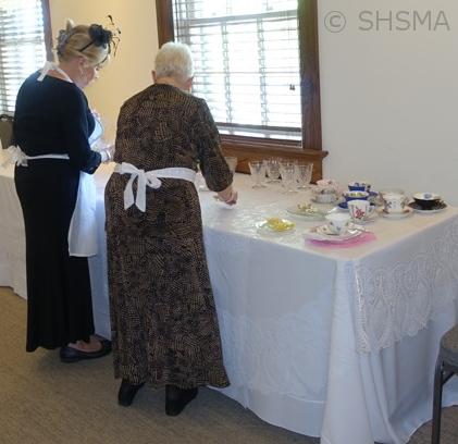 Volunteers preparing the tea service