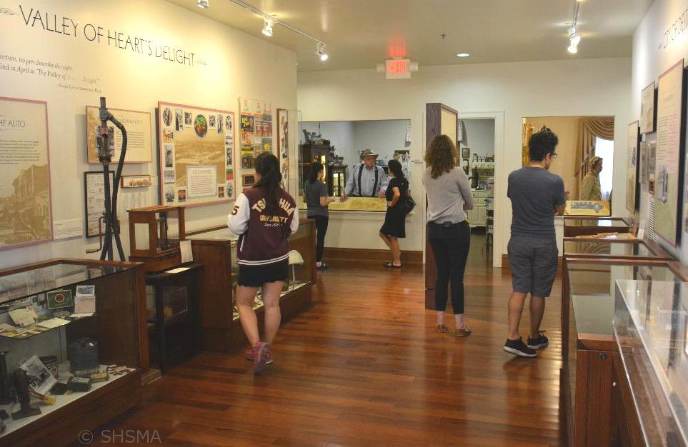 Visitors viewing permanent exhibits